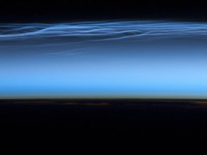 Mesospheric cloudstypically appear as delicate, shining threads against the darkness of space--hence their other names of noctilucent or 'night-shining' clouds.