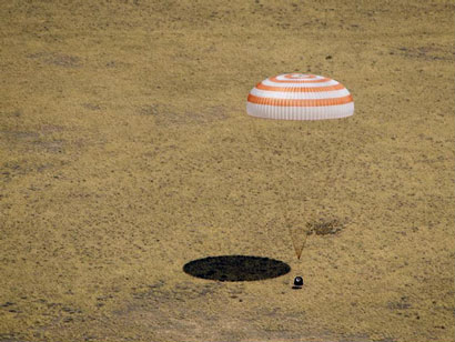 The Soyuz TMA-03M spacecraft is seen as it lands with Expedition 31 Commander Oleg Kononenko of Russia and Flight Engineers Don Pettit of NASA and Andre Kuipers of the European Space Agency in a remote area near the town of Zhezkazgan, Kazakhstan, on Sunday, July 1, 2012.